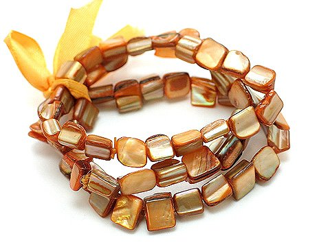 PEACH MULTI STRAND SHELL BEAD RIBBON BRACELET