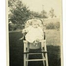 BABY IN HIGH CHAIR OUTSIDE REAL PHOTO POSTCARD RPPC