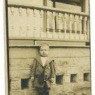 RPPC BOY IN FRONT OF PORCH WOOD SPINDLES CUTE SUIT