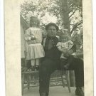 RPPC FATHER AND TWO GIRLS CUTE DRESSES HENRY SALTER