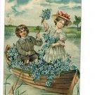 BOY GIRL CANOE BLUE FLOWERS VINTAGE POSTCARD