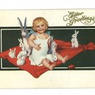 EASTER GREETINGS GIRL ON BLANKET WITH RABBITS  POSTCARD