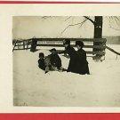 RPPC WOMEN AND CHILDREN IN SNOWBANK FUR HATS FENCE
