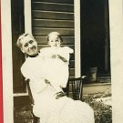 RPPC GRANDMA WITH GLASSES & BABY  WOOD ROCKING CHAIR