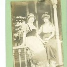 RPPC TWO WOMEN SITTING ON PORCH FANCY HATS POSTCARD