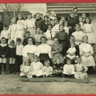 RPPC LARGE GROUP OF MEN WOMEN CHILDREN  FRONT OF HOUSE