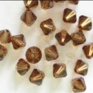 20 Pcs Swarovski Crystals Smoked Topaz 6mm 5301 Bicone