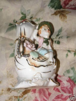Porcelain Figurine with Vase trimmed in Liquid Gold