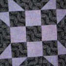 Unique Purple and Black Quilt
