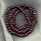 "Opaque Luster Burgundy 9X7mm Handmade Indian Glass Crow Beads 24"" strand"