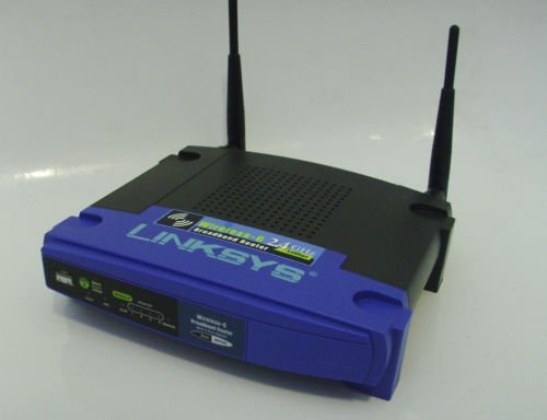 Wirless router Linksys WRT54GS v7 Router W/Speedbooster,4PORT,ORGINAL AC ADAPTER EXCELLENT CONDITION