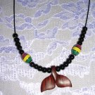 HAND CARVED EXOTIC ROSE WOOD WHALE TAIL PENDANT w RASTA CERAMIC BEAD ADJ NECKLACE