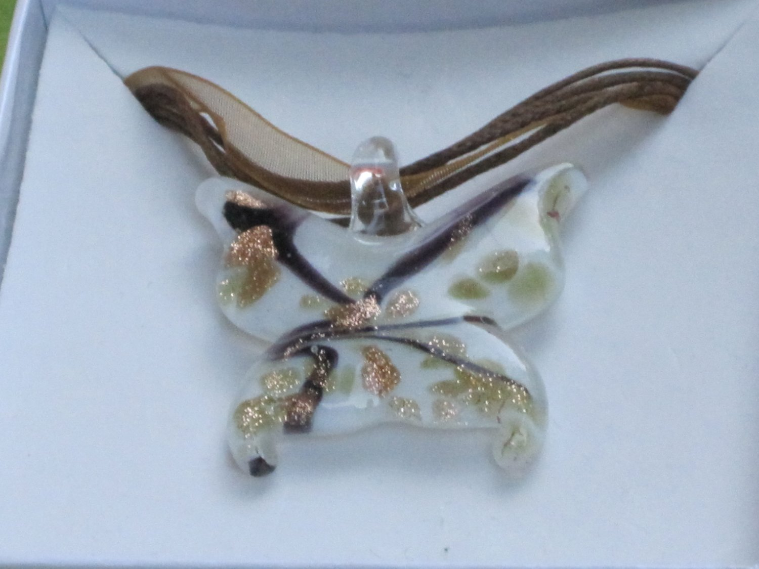 white butterfly glass necklace with gold speckles