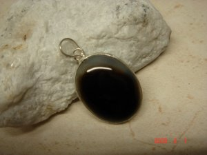 .925 sterling black & clear onyx pendant. 11/4""