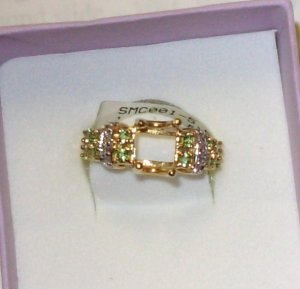 SEMI MOUNT 14KT YELLOW GOLD WITH TSAVORITE DIAMONDS HOLDS 8X6 EMERALD CUT SIZE 7.5