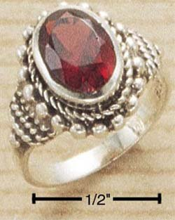 STERLING SILVER FACETED OVAL BEZEL SET GARNET (10MM X 7MM OVAL) RING
