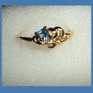 Lovely Round Cut London Blue Topaz CZ & Ocean Wave Design Gold Tone Ring