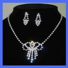 White Rhinestone Bow Shaped Necklace and Dangle Post Earrings Silver-Gilt Set