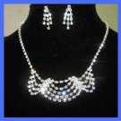 White Rhinestone 4 Tier Necklace and Dangle Post Earrings Silver-Gilt Set