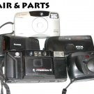 lot of (5)  five   35mm  film cameras Canon , Kodak  & Minolta   For parts - not working