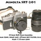 Minolta SRT-201 35mm SLR Film Camera  45mm Lens, snap cap, 49mm sky filter,  cap keeper  135mm lens