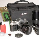 Vintage Canon AE-1 35mm SLR Film Camera , 28mm,, 35-70mm, 200mm, pol. filter, case, straps, pc cord,