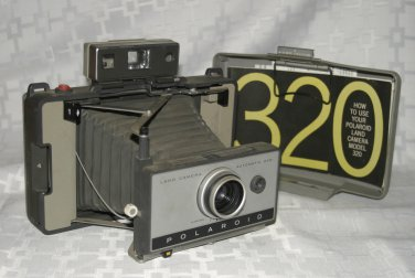Polaroid 320 Instant Film Folding Land Camera tested works with book