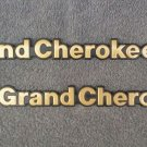 OEM Jeep Grand Cherokee Body/Dash Emblems. RARE Gold Color!