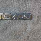 OEM Mazda Body/Dash/Trunk Emblem. 9cm
