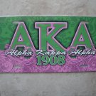 AKA license tag (pink & green)