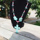 Turquois cross with black and pink accents and chunk howlite