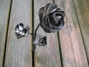 Triple metal rose sculpture