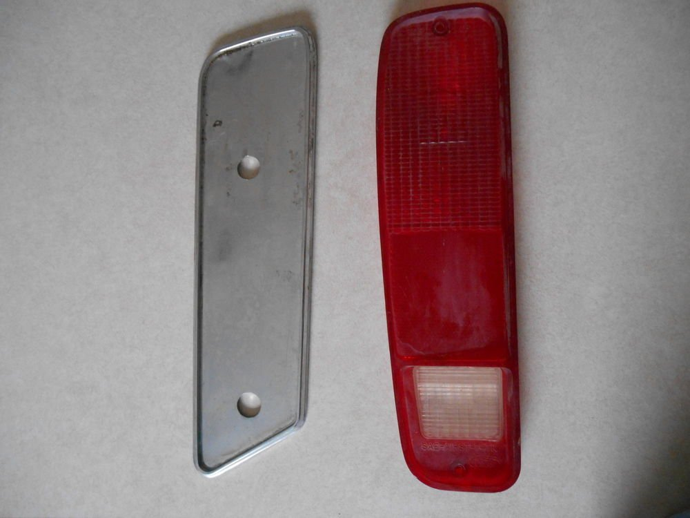 74-79 FORD TRUCK. 75-91 VAN. LH, OEM TAIL LIGHT LENS with extra chrome part