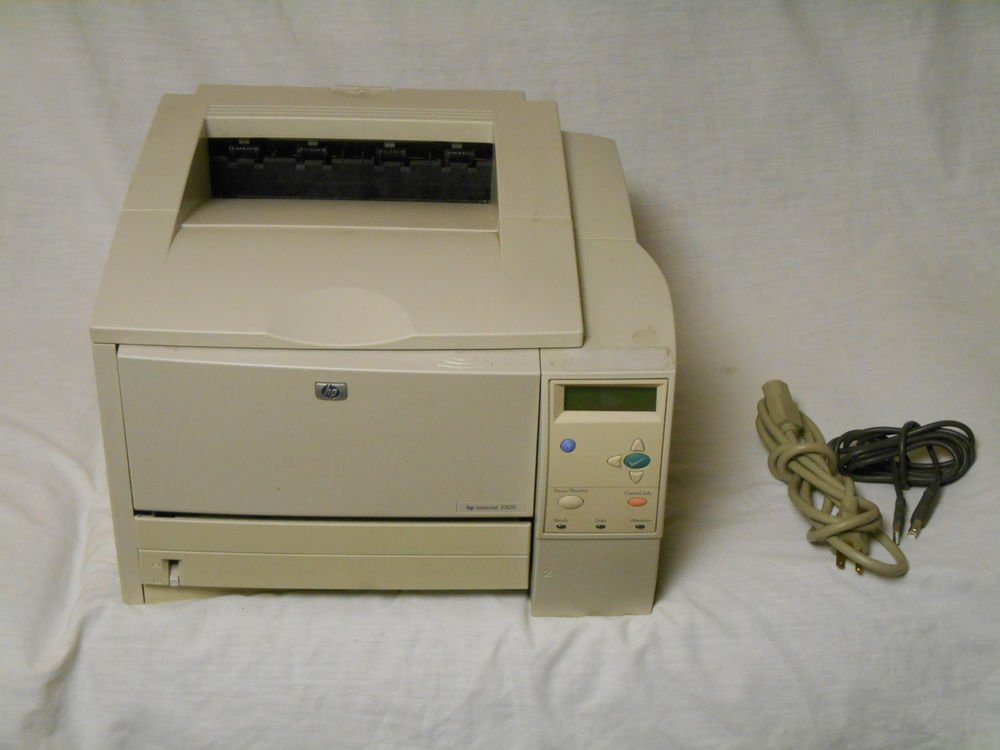 HP LaserJet 2300 Workgroup Laser Printer with power and USB cable.