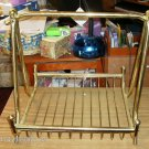GOLD TONED NEWSPAPER RACK - STYLISH