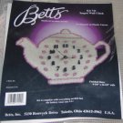 PINK AND WHITE TEAPOT CLOCK FROM BETTS - FLOWERS-CUTE