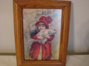 Metropolitan Life Insurance Co. Card in Wooden Frame