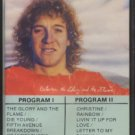 RANDY STONEHILL--BETWEEN THE GLORY AND THE FLAME Cassette Tape (CANADA)