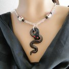 Set 9 Necklace and Earrings Snake With Skulls
