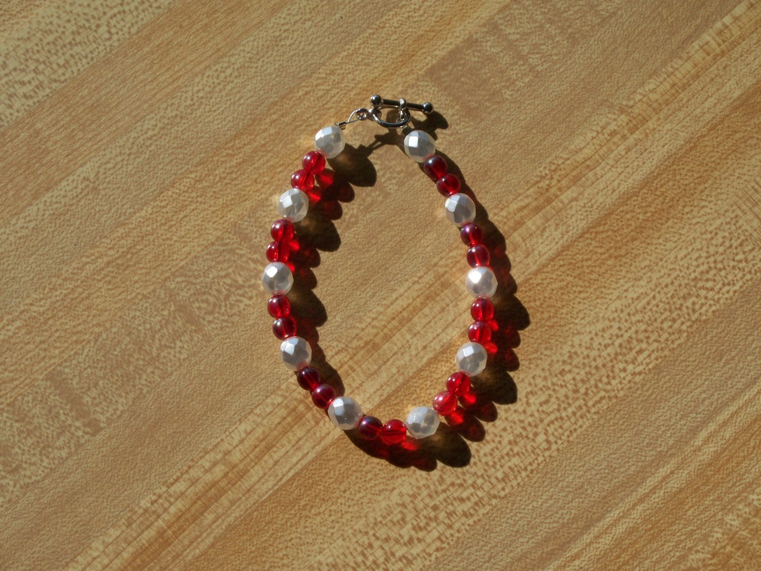 Red with faceted pearl colored beads