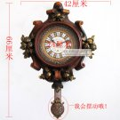 Antique Inspired Wall Clock in Polyresin With Pendulum