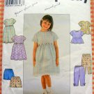 Girl&#39;s Dress, Capri Pants, Top and Shorts Sewing Pattern Simplicity 8576