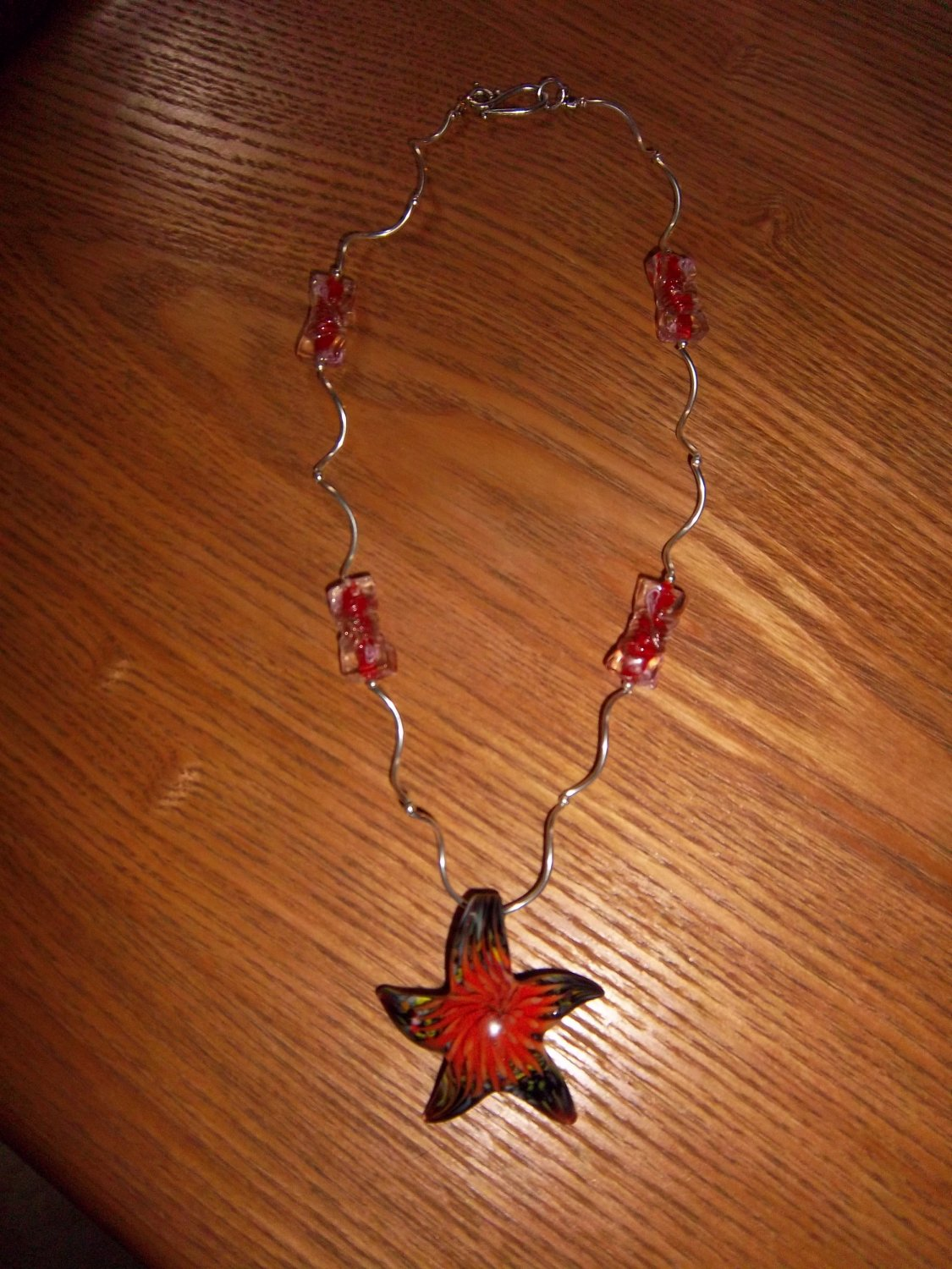 red necklace with pendant
