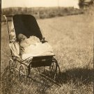 Vintage Photo Postcard Showing Baby in Carriage