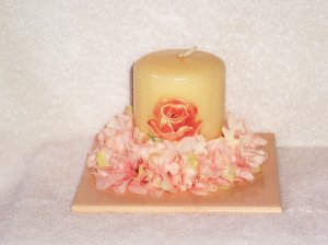 Decorated candle on decorated tile
