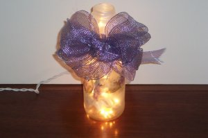Lighted Glass Bottle Decorated with Flowers