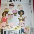 McCall's Pattern M 6052 Party set Child's Apron Treat Bag Wall Art Headband Purse Gift Boxes, UNCUT