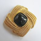 Black Sugarloaf Cabochon Brooch, by Trifari. c. 1980s