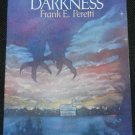 This Present Darkness novel by Frank E. Peretti - paperback book