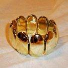 Vintage Design Oval Looking plastic Stretch Bangle Bracelet Golden Color
